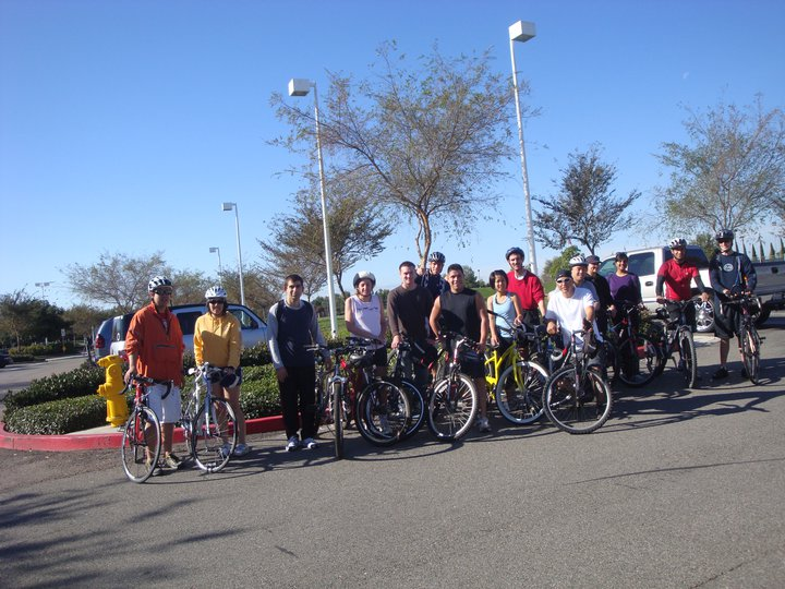 Alumni Students standing next to bikes