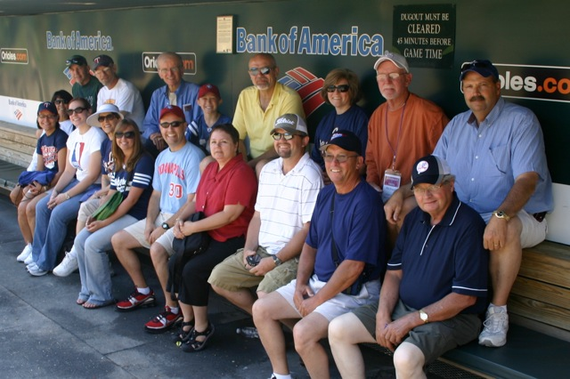 Group in Orioles dugout on a private stadium tour