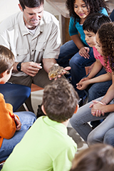 Teacher talking with pre-teen students