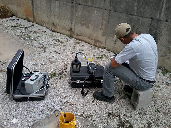 Jose Mattos sampling water from a well