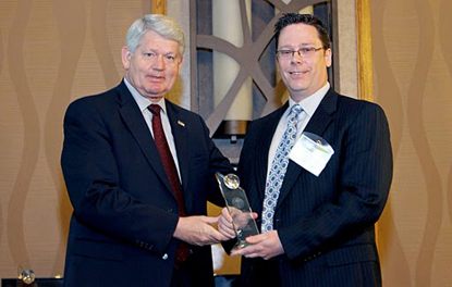 accepting Governor's Award for Excellence