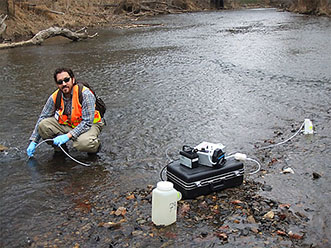 Jonathan Baker sampling the Eno River