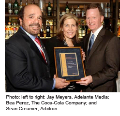 Jay Meyers, Adelante Media and Sean Creamer, Arbitron presenting Bea Perez, The Coca-Cola Company with an award.
